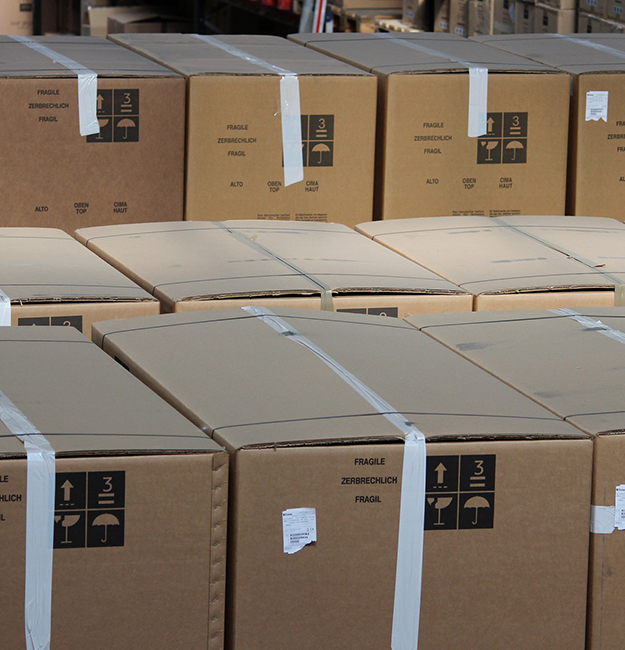 Large brown cardboard boxes of stock in a warehouse
