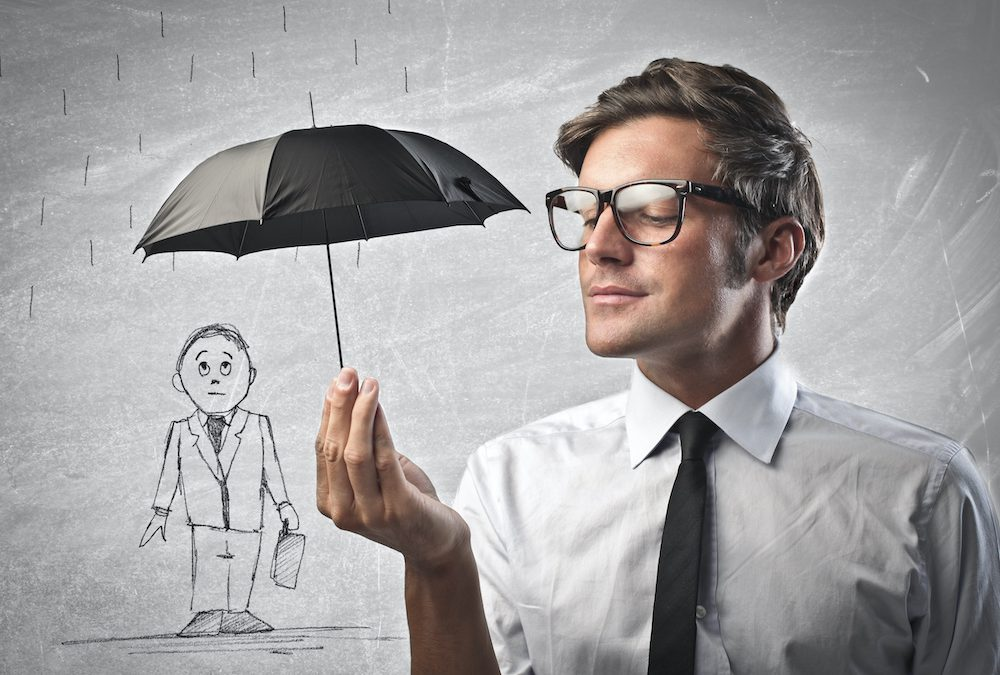 Man in shirt and tie holding black umbrella over small cartoon businessman